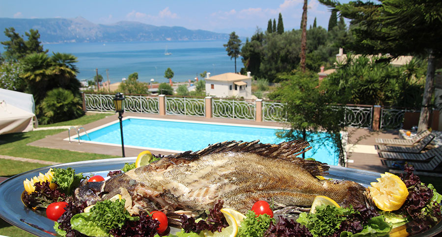 Fresh Fish from the Villa 1870 Corfu's Chef with the blue Ionian Seas view, during a cookin lesson